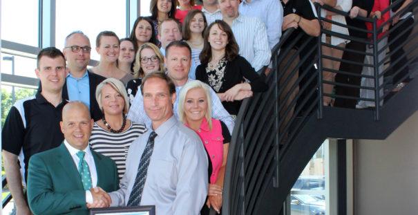 Plains Commerce Bank Mortgage team receives Rural Development Award from the USDA's Bruce Jones.